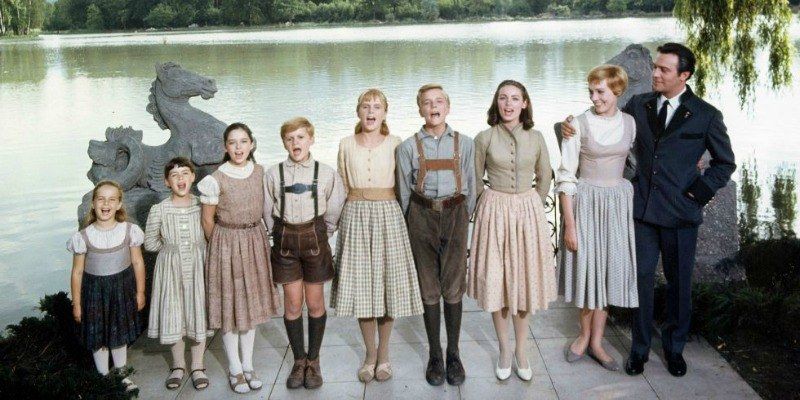 The cast of The Sound of Music lined up signing.