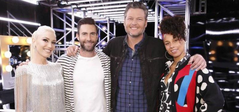 Blake Shelton, Gwen Stefani, Adam Levine, and Alicia Keys smile at the camera