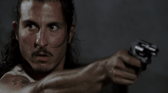 Tomas aims his gun in the prison in a scene from Season 3 of 'The Walking Dead'
