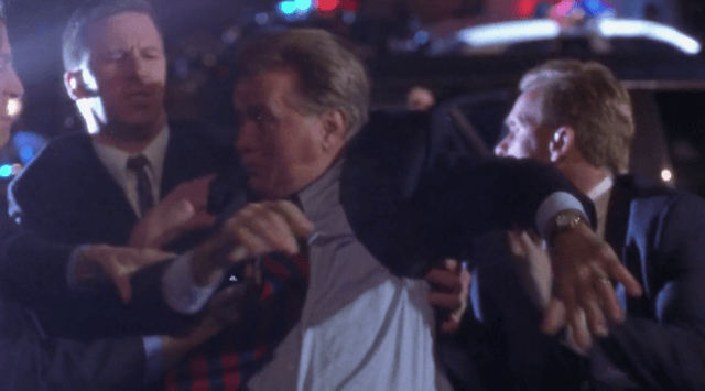 Secret Service officers grab President Bartlett as shots ring out in a scene from 'The West Wing' Season 1 finale.