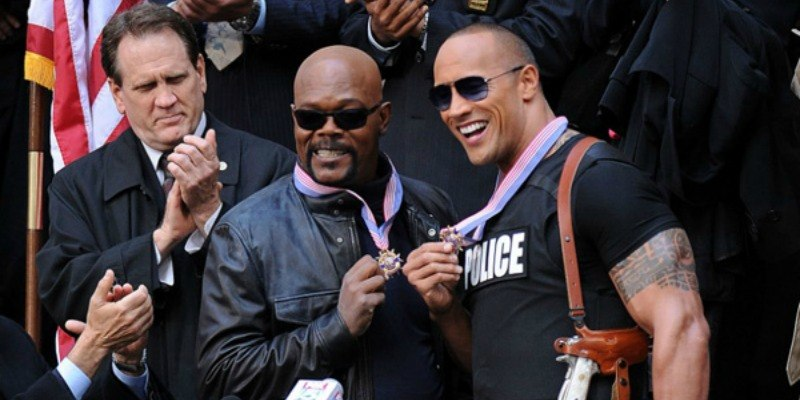 Dwayne Johnson and Samuel L. Jackson are posing together with medals for The Other Guys.