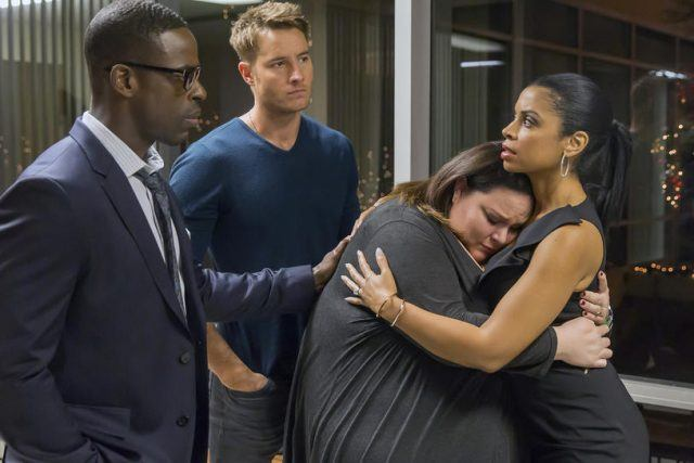 Kate hugs Beth while Randall and Kevin look on, concerned, in a scene from the 'This Is Us' episode 'Last Christmas'
