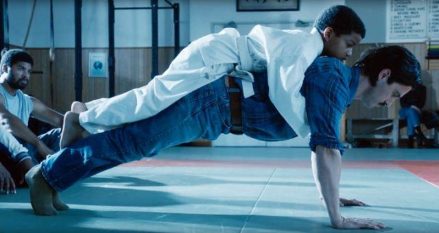 Jack balancing Randall on his back as he does push-ups in the 'This Is Us' episode 'The Trip.'