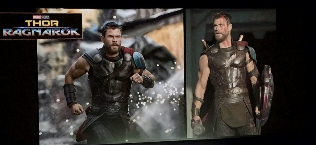Thor runs into a battle in one image, and stands looking to his right in the other