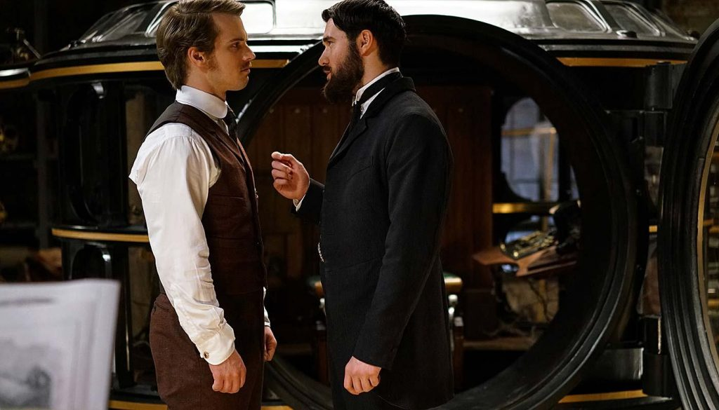HG Wells and Jack the Ripper talk in front of a time machine in ABC's Time After Time