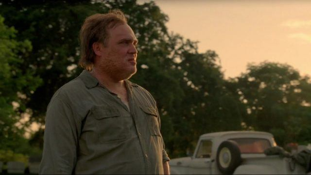 Errol Childress stands in front of a pick-up truck in a scene from Season 1 of 'True Detective.'