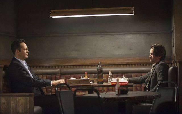 Frank and Ray sit across from one another in a bar booth in a scene from Season 2 of 'True Detective.'