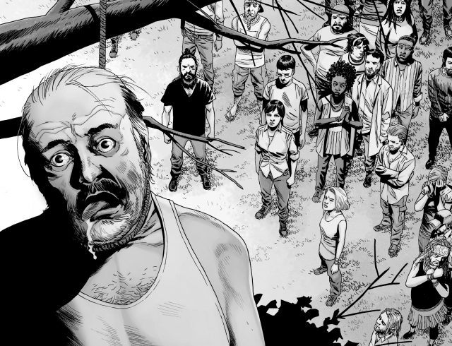 Gregory hangs from a tree as members of the Hilltop colony watch in a panel from 'The Walking Dead' comics.