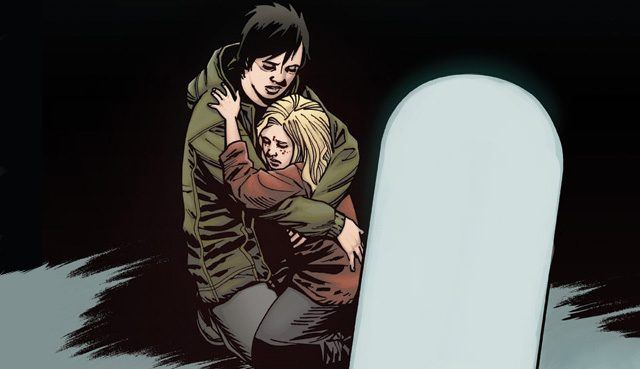 Maggie and Sophia embrace and cry in front of a gravestone in a panel from 'The Walking Dead' comics.