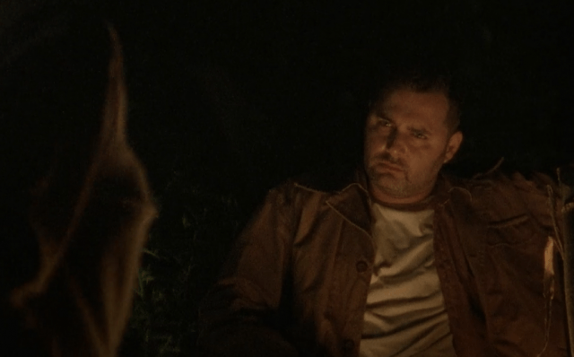 Ed sits by the fire in a scene from 'The Walking Dead' episode 'Tell It To the Frogs'