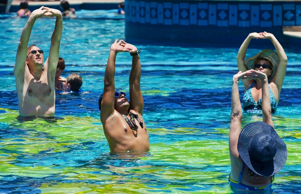 Tourists take in some noontime water aerobics in the hotel pool