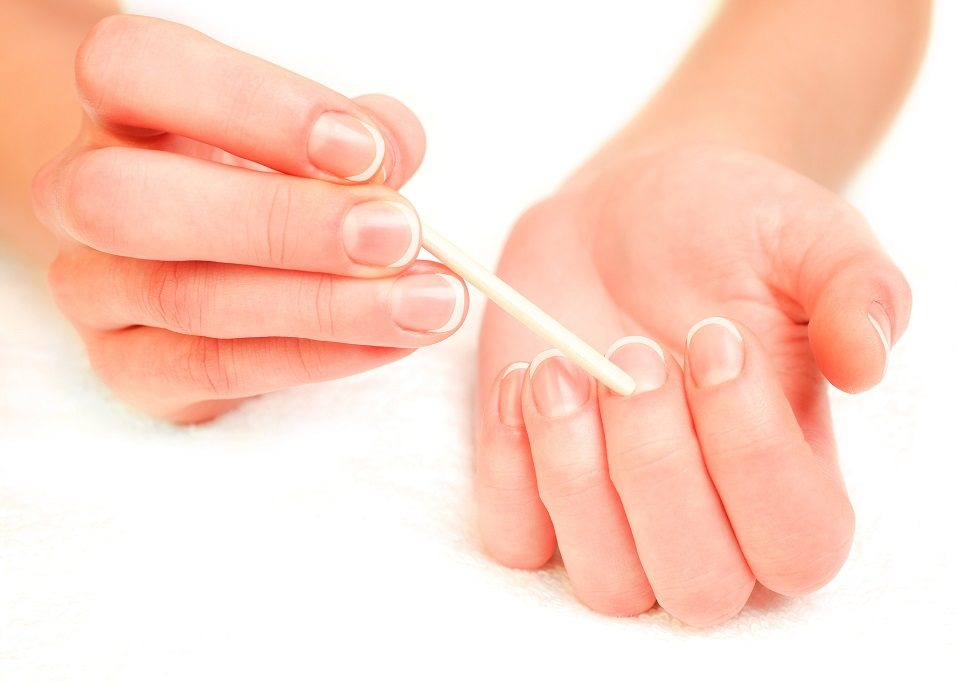 woman pushing cuticles
