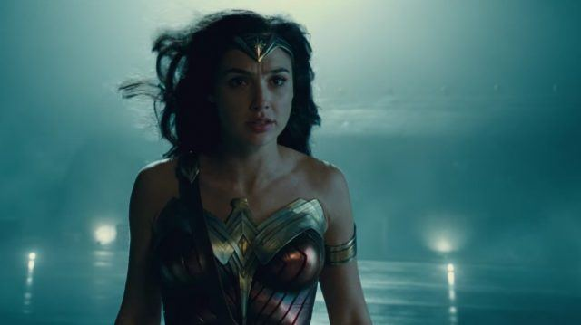 Gal Gadot as 'Wonder Woman' standing in the rain and wind.