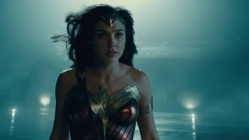 Gal Gadot stands and stares ahead as Wonder Woman
