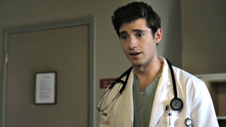 Wren Kingston on Pretty Little Liars brown-haired man in a lab coat wearing a stethoscope in a doctor's office