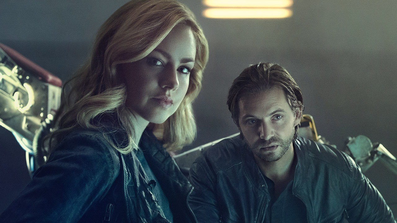 Aaron Stanford and Amanda Schull pose together in a poster from 12 Monkeys