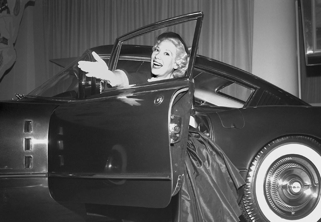 Actress Dina Shore with the 1954 Chevrolet Corvette Corvair concept
