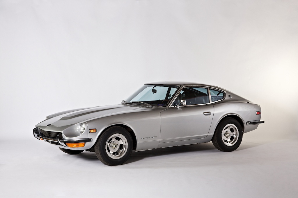 A silver 1971 Datsun 240Z on display.