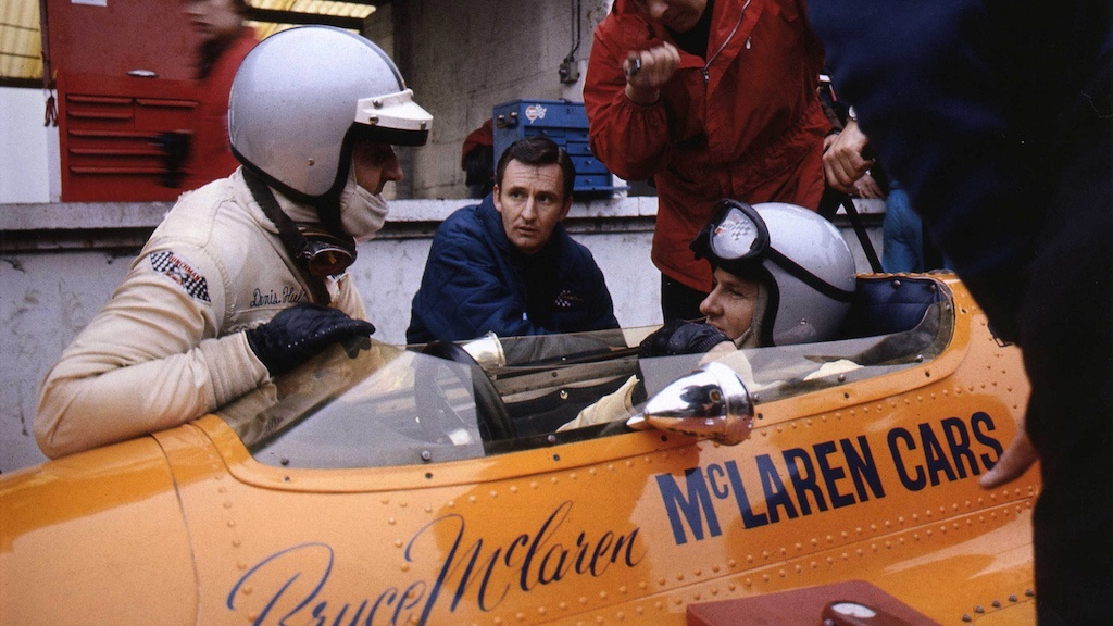 Bruce McLaren in a racing vehicle.