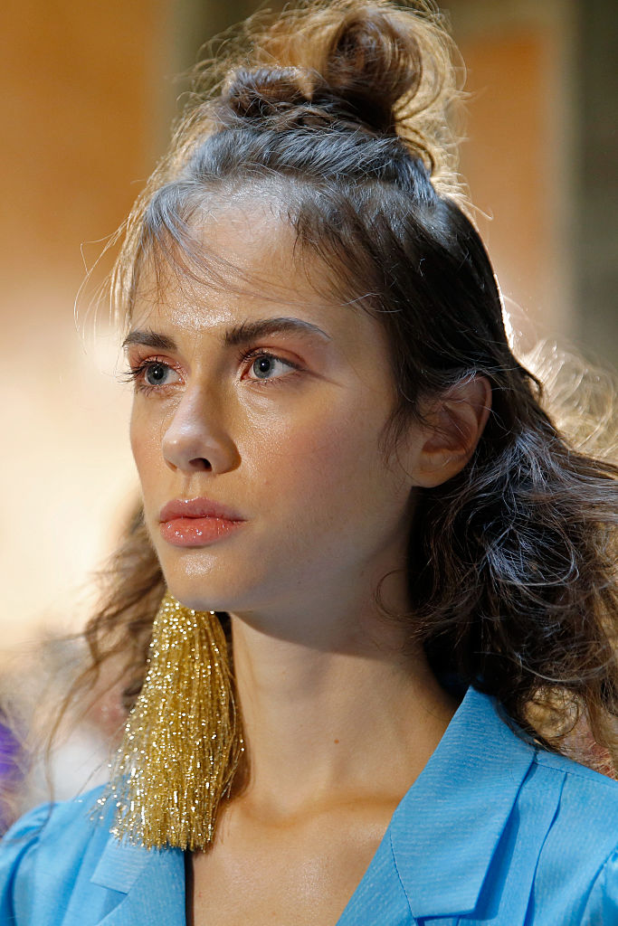 A model, earring detail, seen backstage