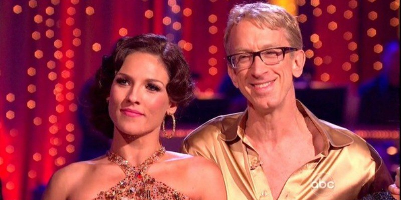 Andy Dick is smailing with his dance partner on Dancing With the Stars.