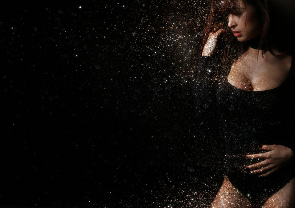 woman creating a glitter dispersion