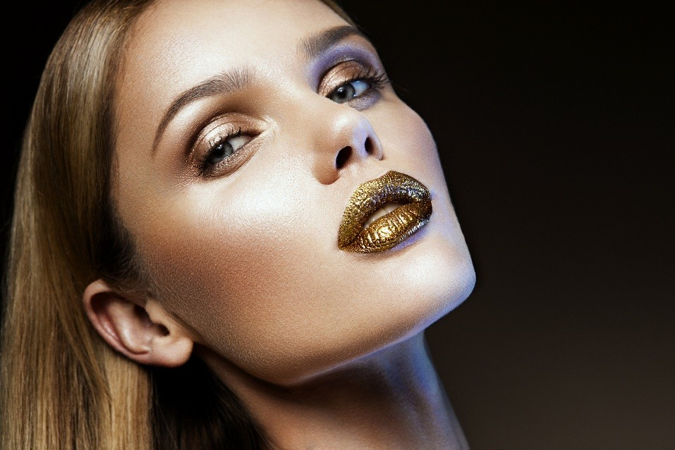 girl with gold glitter