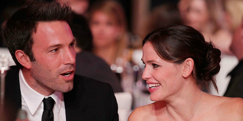 Ben Affleck is talking and Jennifer Garner is looking at him smiling.