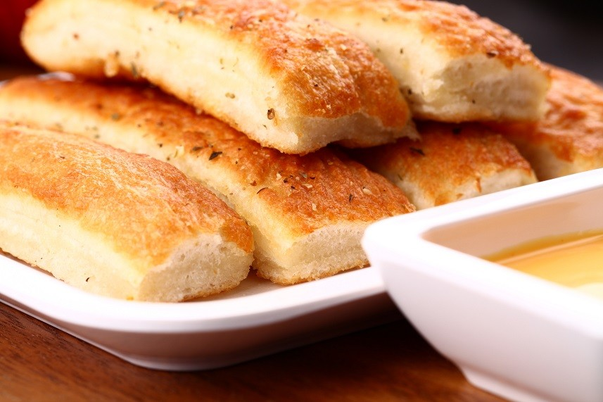 breadsticks served with dip sauce