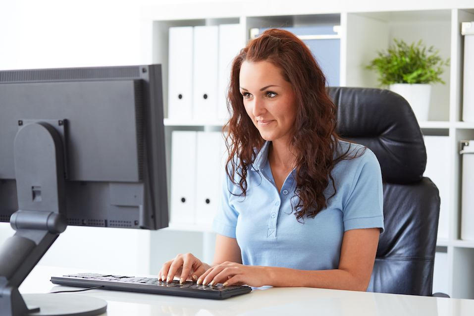 Businesswoman writing on a computer in the office