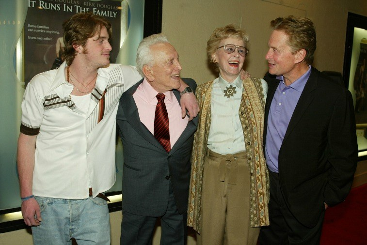 Cameron, Kirk, Diana, and Michael Douglas with their arms around each other at the premiere of 'It Runs In The Family'