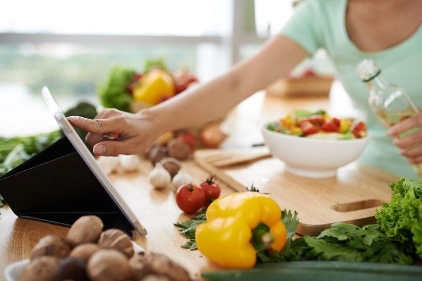 Woman checking recipe