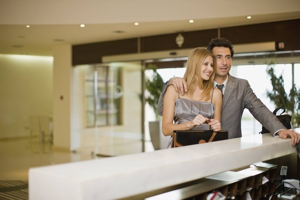 Couple standing on hotel reception
