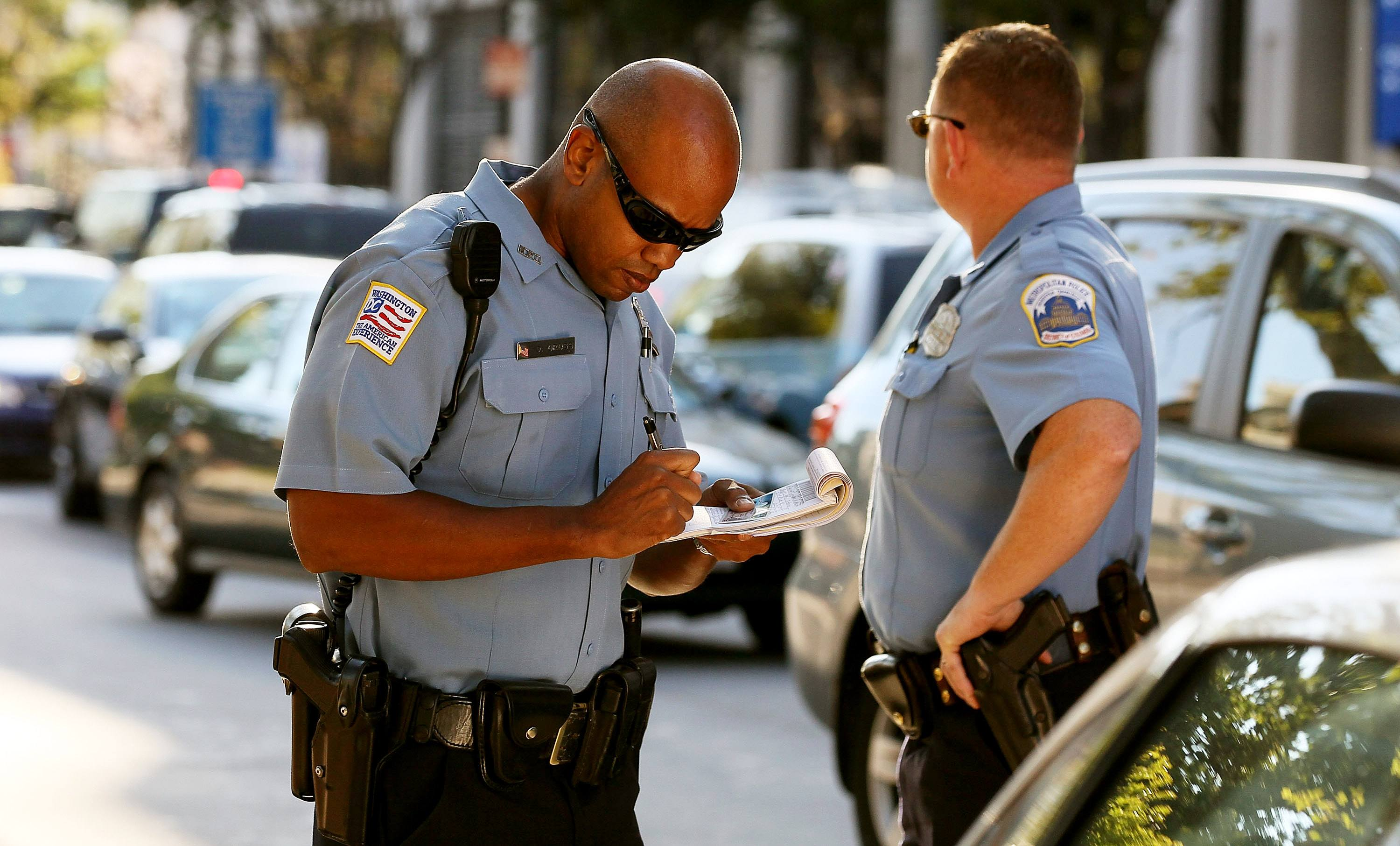 police officers writing ticket