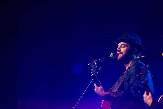 Mark Ballas sings with guitar
