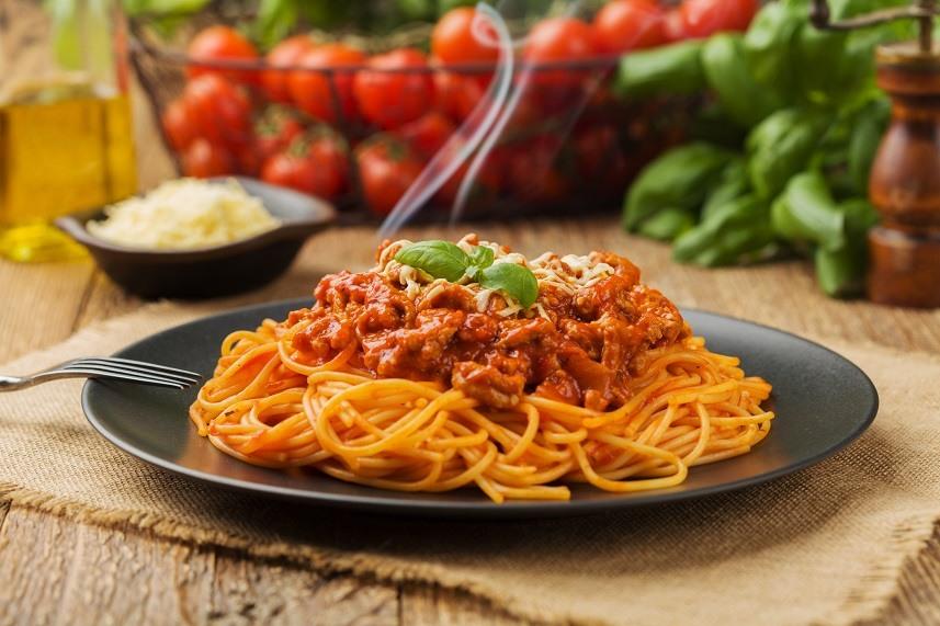 spaghetti served on a black plate