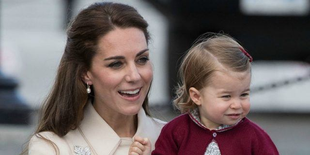 This is a closeup of Duchess Kate Middleton holding Princess Charlotte.
