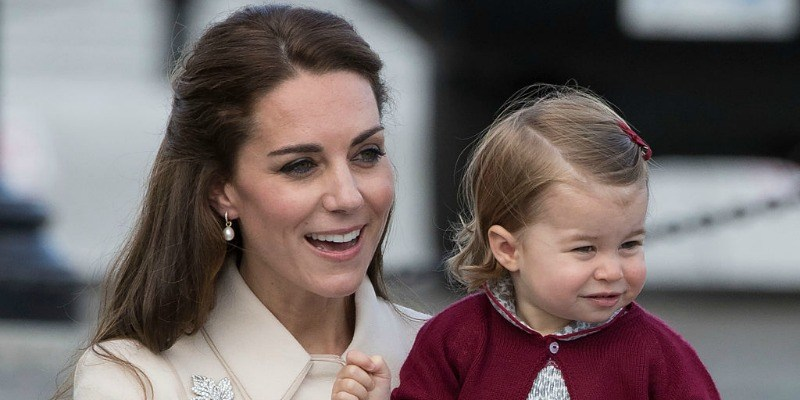 This is a closeup of Duchess Kate Middleton is holding Princess Charlotte.