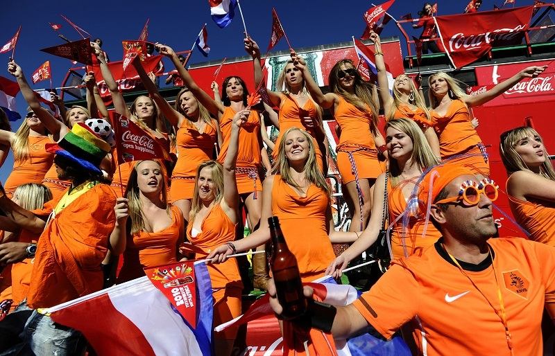 Dutch fans all dressed in orange cheer on their national team.