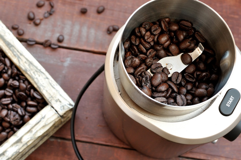 Electric coffee grinder with roasted coffee beans