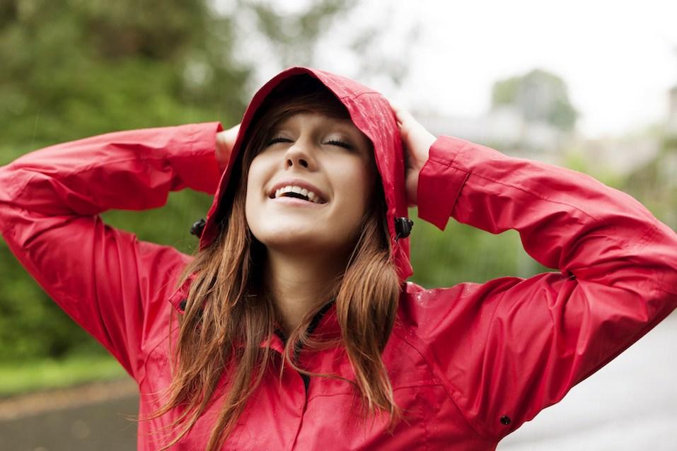 Pretty lady enjoy the rainy day