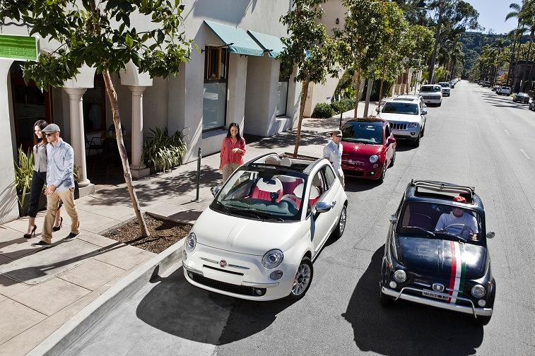 The 2017 Fiat 500c next to the classic car.