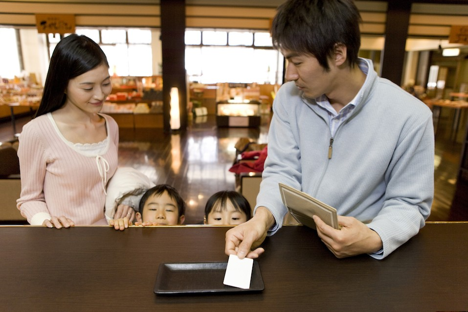 Family making payment from card