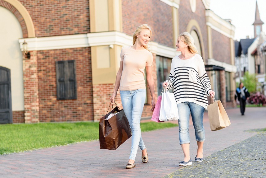 Joyful mother and daughter are going shopping