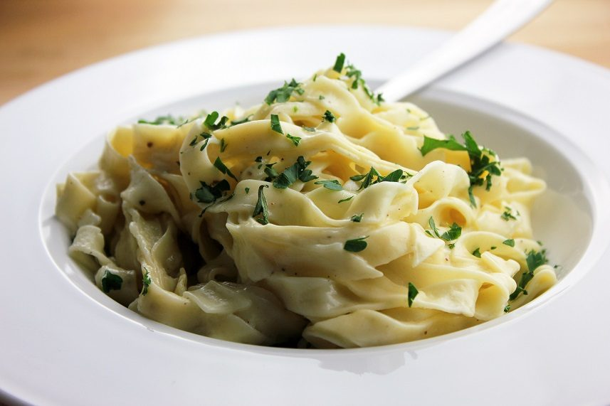 Fettuccine Alfredo garnished with chopped parsley