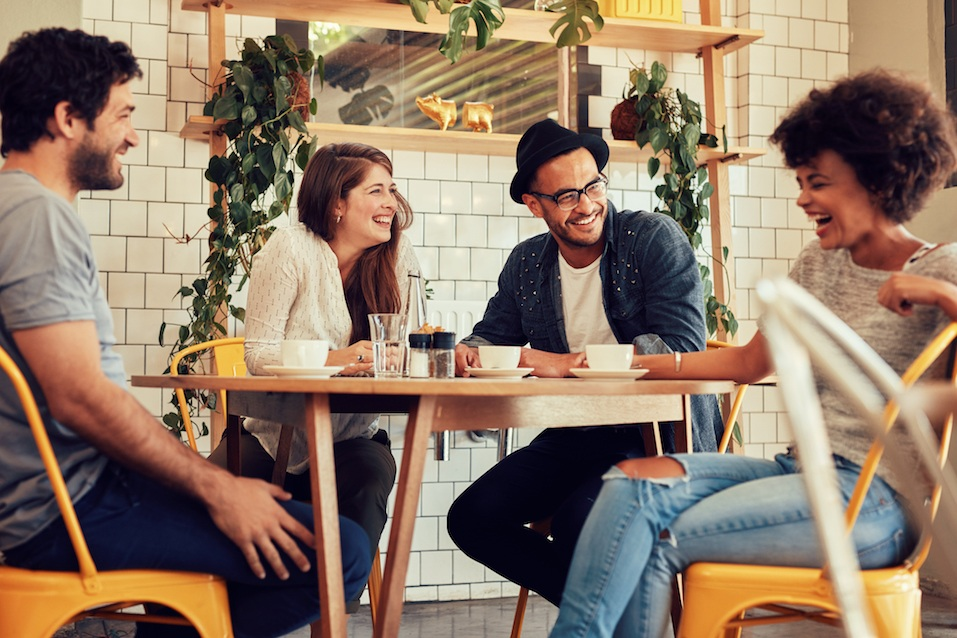 Friends having a great time in cafe