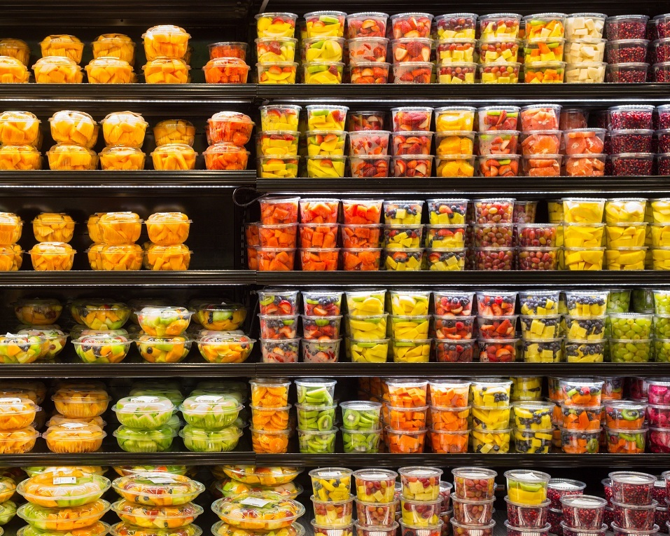 Cut fruit in containers on display