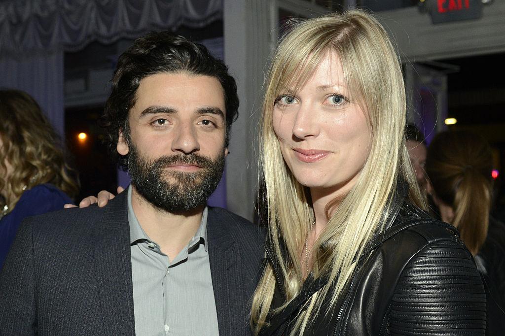 A bearded Oscar Isaac smiles alongside Elvira Lind
