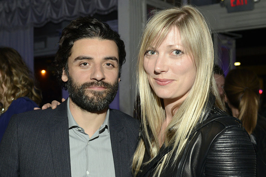 A bearded Oscar Isaac smiles alongside Elvira Lind