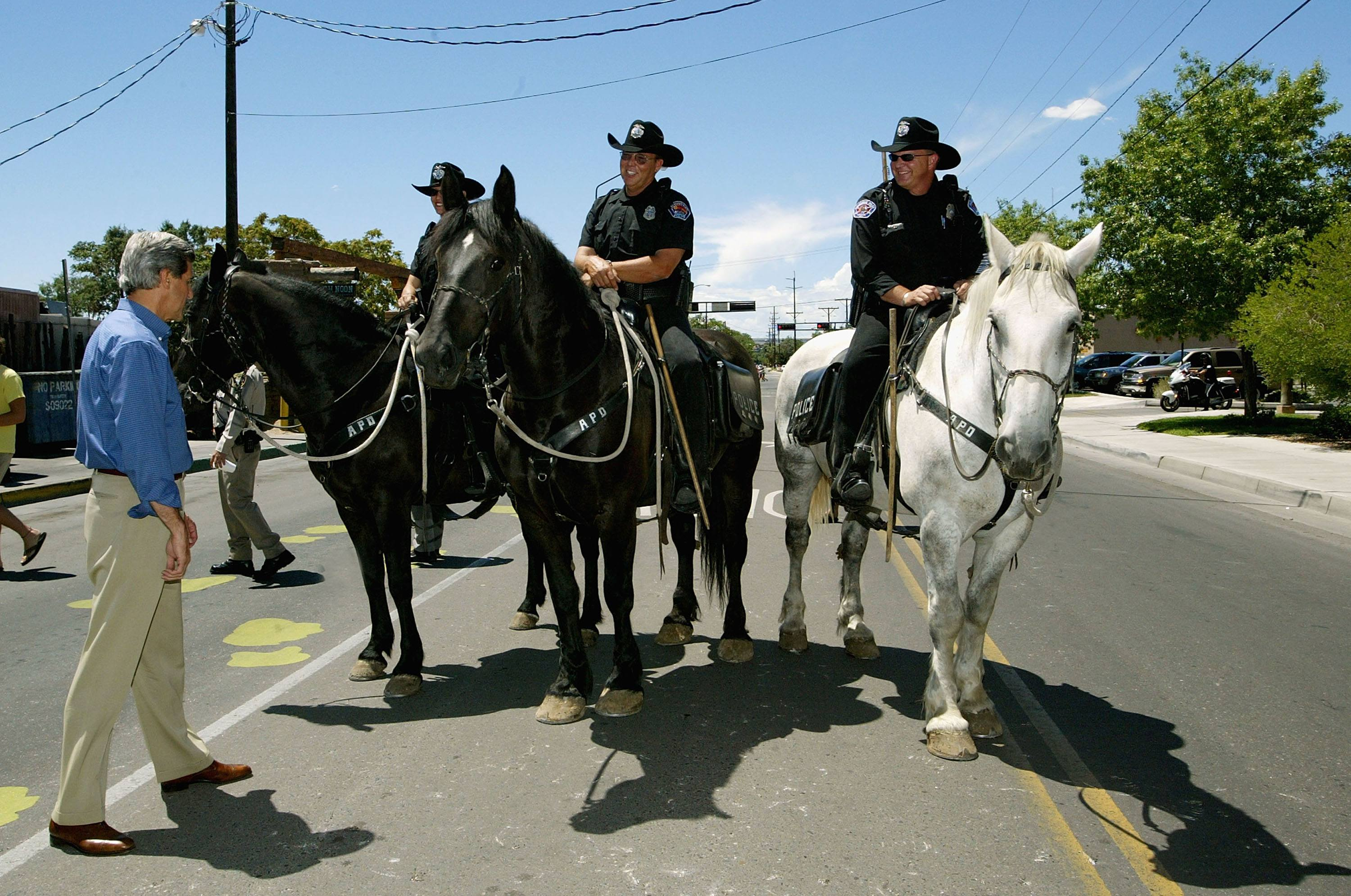 John Kerry greets a group of mounted Albuquerque police officers